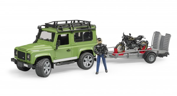 Land Rover Defender Station Wagon mit Anhänger, Ducati Scrambler Cafe Racer und Fahrer