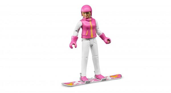 Snowboardfahrerin mit Zubehör